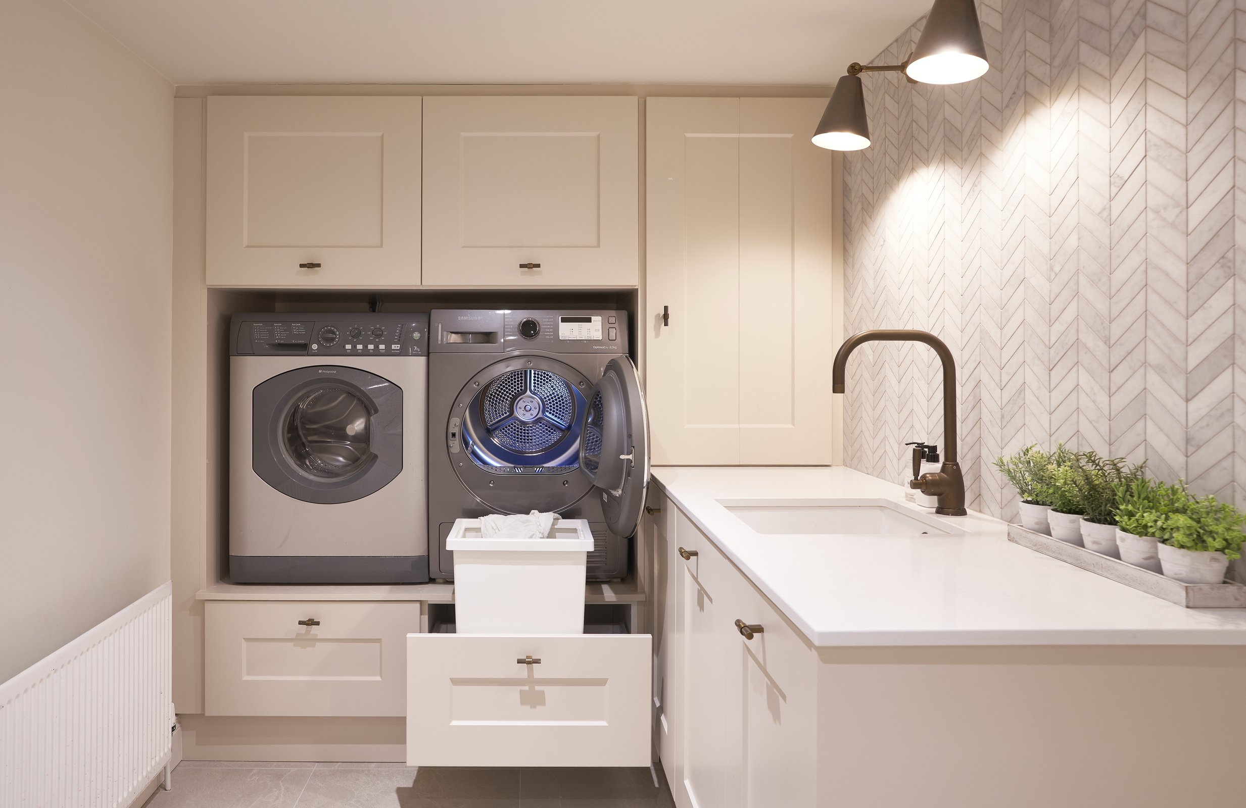 cream laundry room with tiled wall