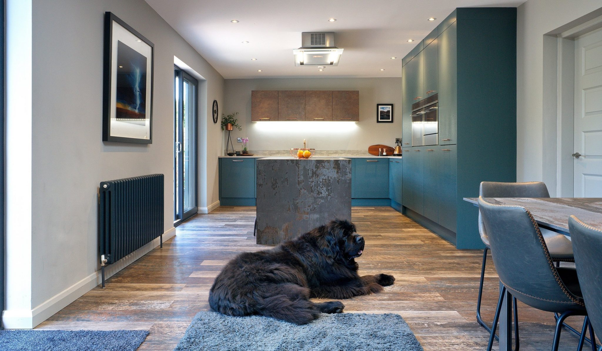 modern teal kitchen with nekton work surfaces