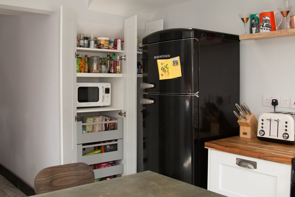 Compact kitchen with retro fridge and larder